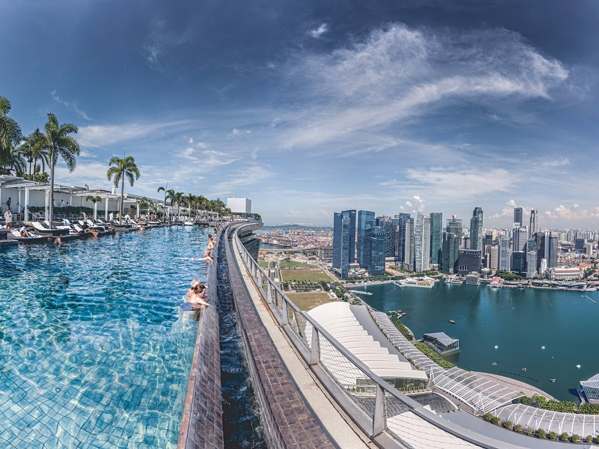 stare-out-at-singapores-skyline-while-taking-a-dip-in-the-incredible-57-story-high-infinity-pool-at-the-marina-bay-sands-hotel